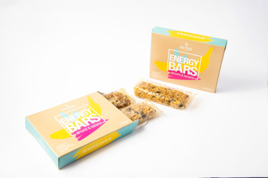 two boxes of almond banana bars, one open where you can see bars