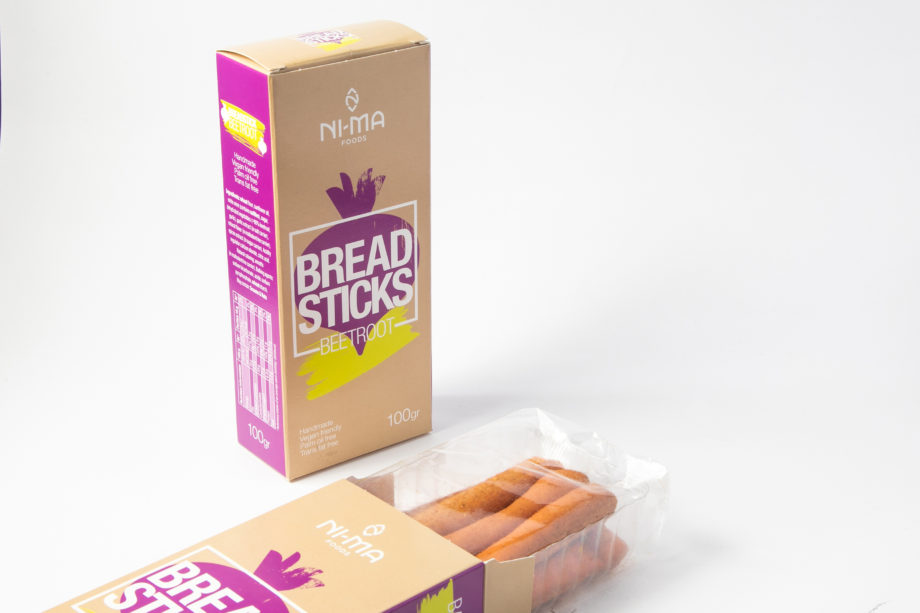 two boxes of beetroot breadsticks one open